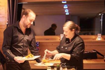 Jen & Craig serve dinner at Chalet Virolet