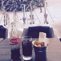 A well earned coke & chips on Piste 64 in Les Gets