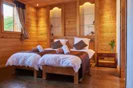 Twin beds in a family room at Chalet Virolet